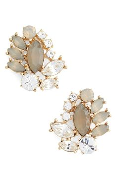 Clusters of dazzling, softly hued jewels make up these vintage-inspired cluster earrings that finish the wedding day look with elegance and ease.