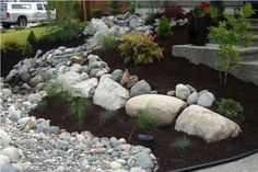 The experts at Scotty's Landscaping & Design combine creativity and problem solving with an eye for balance and uniqueness, to create a natural look that complements the best features of your yard. And there's no need to lose all that at night -- we do lighting too! ScottysLandscaping.com Landscaping With Rocks, Landscaping Design, Front Yard Landscaping, Natural Stone Wall, Natural Stones, Modern Front Yard, Natural Looks, Surrey, Garden Beds