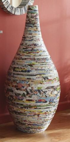 This would be time consuming but could be a project for a long weekend...though if I'm lazy I could just buy it...Recycled Magazine Vase - Country Door
