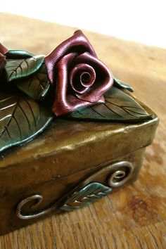 Gold Box with Red Roses and Green Leaves