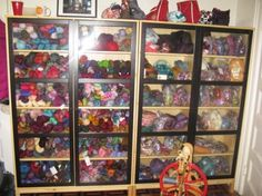 Yarn storage ideas -Great covered yarn storage, but you still get to view all the beauty through the clear doors. Cute Ladybug wheel too!