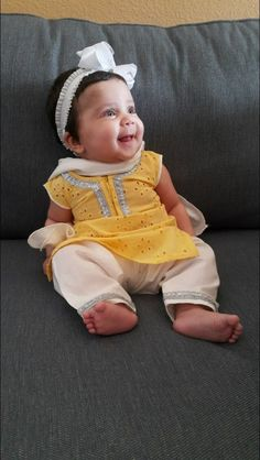 This 4-month old baby is rocking her Desi Fashion, wearing a simple Yellow Chicken Kameez with silver detailed Shalwar.  She wore this Shalwar Kameez to sport her Friday look! Absolutely adorable #microfashion