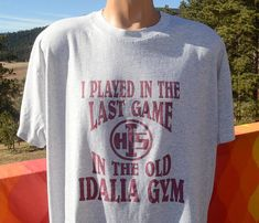 Tag: Hanes  Era: late 80s to early 90s  Fabric: 50-50  Size reads: XL - fits slightly on modern Large side, please check measurements  Measures: 24 inches across the chest, 29 inches back collar to hem  Colors: light heathered gray t-shirt with maroon I Played in the Last Game in the Old