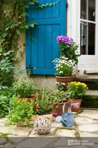 Flower pots and a well maintained garden make your home appealing, especially if it's up for sale.