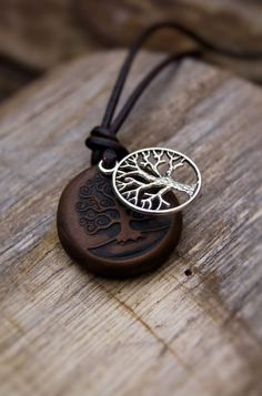 Hey, I found this really awesome Etsy listing at https://www.etsy.com/listing/168658557/tree-of-life-unisex-necklace-on-leather