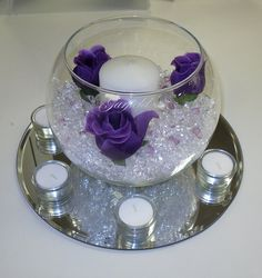 I like the purple roses, but perhaps change the colour of the surrounding tea lights?