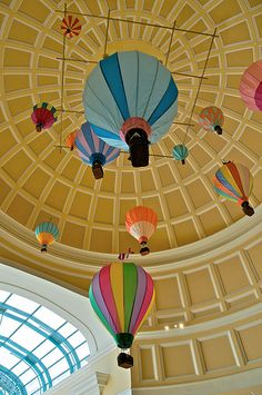 create a hot air balloon mobile to hang from the ceiling (picture is from the Bellagio in Vegas)