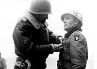 General Anthony McAuliffe recieves the D.S.C.from Ge. George Patton in late Dec. of  1944 at Bastogne
