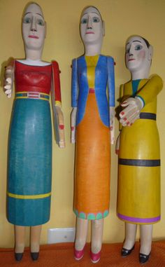 The Venezuelan self-taught wood sculptor José Belandria is known for his charming wooden figures which have been popular with collectors and museums for decades, both in Venezuela and abroad. Belandria's trademarks are elegance of form, articulated arms, greatly over-sized hands, and finely rendered facial features..