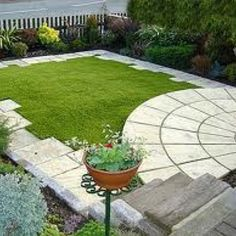 nice staggered edge - horrible round edge! Would be cool to frame out all grassy areas like this with staggered stones
