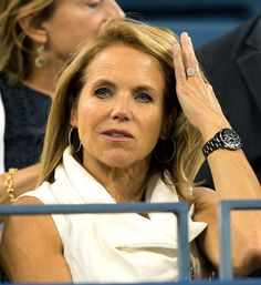 Flaunt that bling! One day after announcing her engagement to boyfriend John Molner, Katie Couric gave a glimpse of her new diamond ring while attending the US Open in New York.