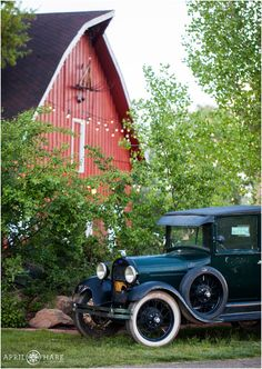 VIntage ford flatbed truck decorates the lawn in front of the red barn on a spring wedding day at Denver Botanic Gardens Chatfield Farms in Colorado. - April O'Hare Photography http://www.apriloharephotography.com