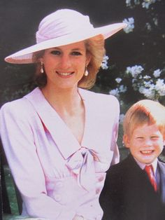 Princess Diana and Prince Harry. Aww look at the smile on his face! Happy child! !
