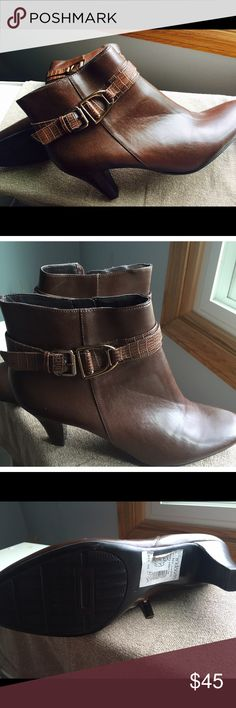 "Bandolino ""Flightie""brown 8 1/2 boots Brown boots size 8 1/2. 3 inch heel. Lightly scratched from sitting in closet but nothing too noticeable. Bandolino Shoes"