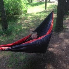 The human kid is starting the #treklight lifestyle early. #camping #hammock via @backcountryk9