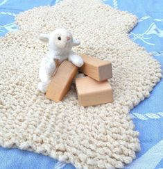 Use a simple chain loop stitch to make your own faux sheepskin play mat . . . perfect for lining a car seat or stroller, adding a snuggly layer of comfort and warmth. Great for pets too!Shaping is charted row by row, making this an easy project for an advanced beginner.