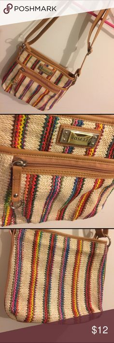 Super Fun Crossbody Adorable like new Crossbody. It's made with a straw like material on the outside with some fun colorful stripes. I've only used this bag a few times so it's in great condition. Feel free to ask questions and make offers! :) Rosetti Bags Crossbody Bags