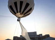 If your dress train is two miles long, then a hot air balloon is a practical method of transportation. As the latest record-we-didn't-know-you could-break, a Romanian design house debuted the longest bridal train known to man. Long Gown For Wedding, Wedding Dress Train, Used Wedding Dresses, Wedding Veil, Wedding Makeup, Balloon Rides, Hot Air Balloon, Wedding Games, Wedding Ideas