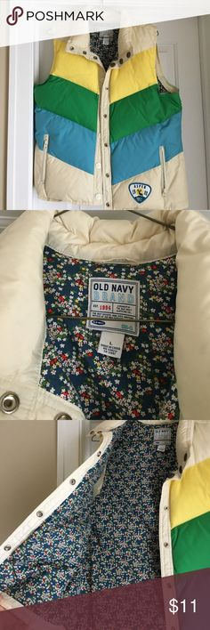 Old Navy Puffer Vest Worn once or twice so I'm very new condition. Size large but could work for a medium as it's a bit snug on me and I typically wear large. Old Navy Jackets & Coats Vests