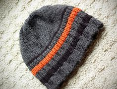 On the hunt for a manly man hat for my manly husbands manly head. I like the orange stripe on this one. 🙂 On the hunt for a manly man hat for my manly husbands manly head. I like the orange stripe on this one. Loom Knitting, Free Knitting, Knit Or Crochet, Crochet Hats, Knitting Patterns, Crochet Patterns, Mens Hat Knitting Pattern, Knit Hat For Men, Mens Knit Beanie