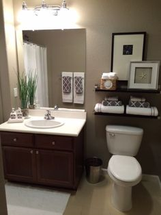 "Another Pinterest win!  Paint color is ""Taupe Tone"" by Sherwin Williams.  Decor inspired by Pinterest.  :-)"
