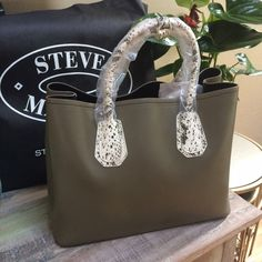 Beautiful Steve Madden bag.‼️NO TRADES‼️ Brand new bag still in bag about 11'h 13.5'L Steve Madden Bags Shoulder Bags