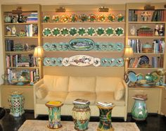 Bookcases with Wedgwood and George Jones Plate collections. Assorted English garden seats.
