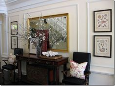 #entryway by designer @Scot Wood. Chairs, clam shell, console table and mirror. Lovely arrangement.