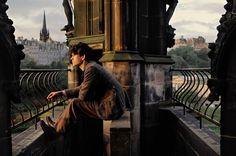 still of Ben Whishaw on top of the Scott Monument in Edinburgh