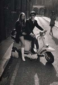 The only way to get around town - together on a Vespa