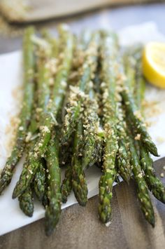 Roasted asparagus tossed with homemade garlic Parmesan breadcrumbs. | chefsavvy.com #recipe #asparagus #vegetables #breadcrumbs