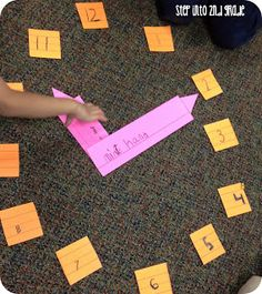 Kids work in groups to make the parts of a clock with cut-up sentence strips.  Then, they got on the floor, put them together, and started to practice making times!