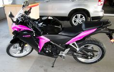 Yep, I think this is pretty similar to what I'd want my bike to look like. My helmet and jacket are both black and pink. Sporty yet with a girly touch - that's my riding style!