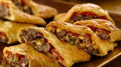 Bacon-Cheeseburger Calzones ~ 4 slices Bacon cut into pcs, 1# lean Hamburger, 1/4 c ea dried Onion, chppd Hamburger Pickles & Ranch Dressing, sliced Tomato, 4 thick slices American/Swiss Cheese in 1/2, 16 oz Crescent Rolls, 1 Egg beaten. Oven 375°F. Cook bacon 2 min., add burger & onion, cook, + pickles & dressing. Unroll dough 4 rect, on ungreased cookie sheet. Spoon 1/3 c mix onto end, top w/tomato & cheese. Fold edges & press edges with fork to seal, brush tops with egg. Bake 15-20 min.