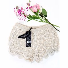 Cream Lace Crochet Shorts Romantic Lace crochet shorts add a little whimsy to your wardrobe. Made in a classy cream color. Made of 65% cotton and 35% polyester.   100% of the profits from any sale in my closet are donated to help someone in need. Janet Paris Shorts