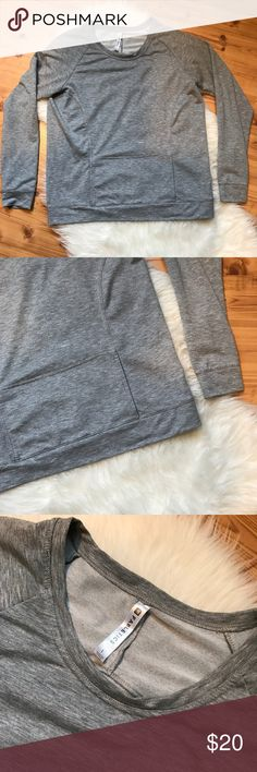 """Fabletics gray pullover sweater top size L Fabletics heathered gray pullover sweater long sleeve top. Kangaroo pocket on front. Size Large. Underarm to underarm 22"""" Length 26.5"""" Fabletics Tops Tees - Long Sleeve"""