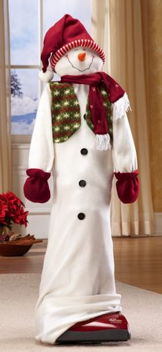 Holiday Snowman Vacuum Cleaner Cover - Turn your vacuum cleaner into a festive conversation piece and put its old closet space to good use. Vacuum cleaner cover has the look of a snowman and even looks terrific displayed by the Christmas tree.  #Christmas #Winter
