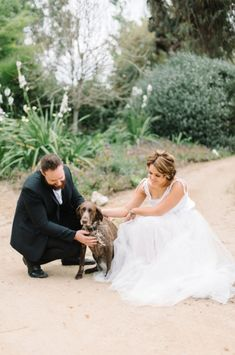 boho wedding couple, flowy wedding dress, boho wedding dress, lace wedding, tool wedding dress, white wedding dress, outdoor wedding photos, field, photography, natural, walking in field, holding hands, posing, couple shoot posing, Liesl le Roux Photography, dog, wedding day dog,