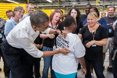 President Barack Obama signs a line worker's shirt after touring the Amazon fulfillment center in Chattanooga, Tenn., July 30, 2013. (Official White House Photo by Chuck Kennedy) Line Worker, Amazon Fulfillment Center, Mr President, Barack And Michelle, Future Jobs, Barack Obama, Role Models, Presidents, Fangirl