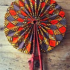 These colorful hand fans are our bestseller. Made out of leather and African print fabric they are a hot accessory for the Summer. Must have accessory! Hand Held Fan, Hand Fans, African Fabric, African Dress, African Accessories, Ankara Designs, Interior Design Elements, Leather Handle, African Fashion