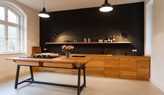 Black, white, wood -perfect kitchen! https://www.urlaubsarchitektur.de/de/haus-bubkevitz/