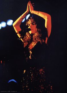 Stevie onstage   ~ ☆♥❤♥☆ ~    arms above her head forming a type of triangle during the 'Tusk' Tour, 1980
