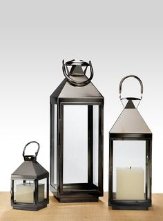 These steel lanterns have a Matte Pewter finish, with clear glass panels. Clean lines in their design make them versatile for both modern and classic wedding, event, and party decor schemes. The 8-inch size fits up to a 3-inch diameter candle. The 1