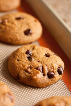 Pumpkin Chocolate Chip Cookies - pillow-y soft, fluffy and moist. You must make them this Fall!