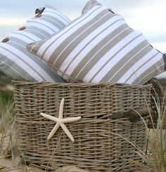 Buy thrift store basket,add starfish and put by one of my side tables in the living room with a couple pillows and a throw in it