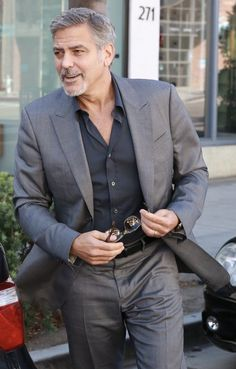 George Clooney with a business casual combo with a gray suit black button up shirt black leather belt sunglasses watch. Grey Suit Black Shirt, Black Button Up Shirt, Black Suits, Casual Suit, Men Casual, Smart Casual, George Clooney, Amal Clooney, Suit Up