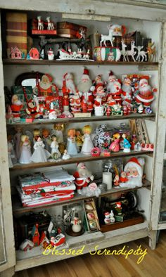 Blessed Serendipity blog.    Cupboard filled with vintage Christmas goodies.  Love it!