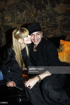 Clotilde Courau and John Galliano attends the Christian Dior Fashion show, during Paris Fashion Week (Ready to Wear) Fall-Winter 2008-2009 at Espace ephemere des Tuileries on February 25, 2008 in Paris, France.