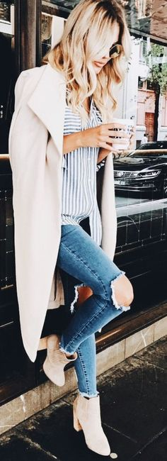 Tan Trench Coat, White/Blue Striped Button Down Top, Light Wash Ripped Jeans, Tan Ankle Booties. #whiterippedjean