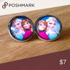 "🆕 XL Elsa & Anna Earrings Handmade earrings with Anna & Elsa images under glass domes. These are XL 16mm.  We offer 15% off on all bundles. You can ""Add to Bundle"" to get discount.  Most items listed are ready to ship but if you need something sooner please let us know before ordering.  Thank you for shopping my closet! Magic Main Street Jewelry Earrings"